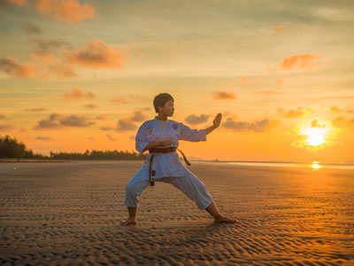 Boy practicing Martial Arts on the beach