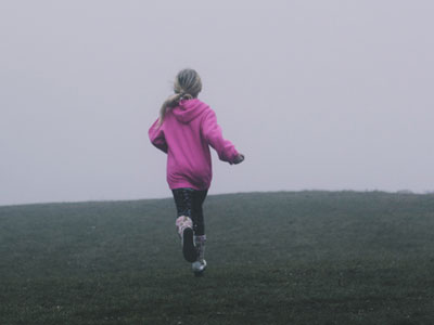 Girl running on a field