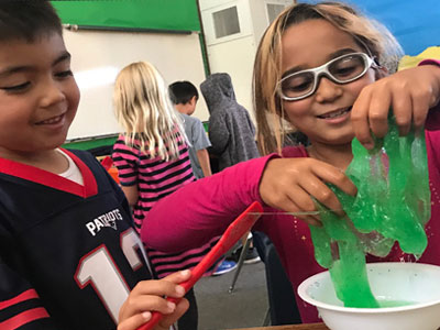 Kids creating slime