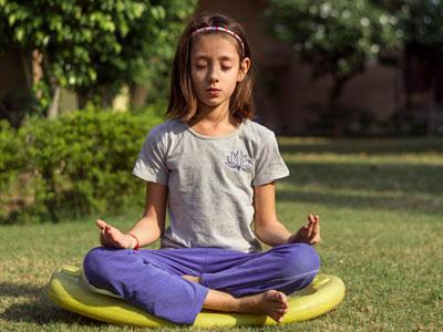 Girl doing yoga outside